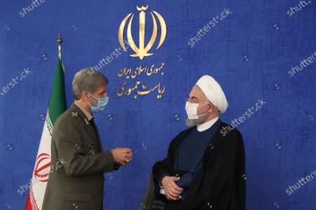 A handout photo made available by the presidential office shows, Iranian president Hassan Rouhani speaks with Iranian defence minister Amir Hatami (L) during a cabinet meeting in Tehran, Iran, 20 September 2020. Media reported that Rouhani called today 20 September a historic day for Iran as US failed to unite EU countries and UN to return UN resolution sanctions against the country. Iran called on the rest of the world to unite against the United States, after Washington unilaterally declared UN sanctions against the Iran were back in force. Washington has said it will 'impose consequences' on any country not complying with the sanctions.