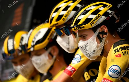 Dutch rider Tom Dumoulin of Team Jumbo-Visma (R) wears a hand-written surgical mask labeled with '# NO TO RACISM' before the start of the 21st and last stage of the Tour de France 2020 cycling race over 122km from Mantes-La-Jolie to Paris, France, 20 September 2020.