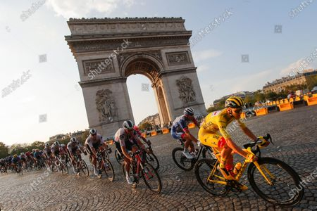 Slovenia's Tadej Pogacar, wearing the overall leader's yellow jersey, rides past the Arc de Triomphe on the Champs-Elysees during the twenty-first and last stage of the Tour de France cycling race over 122 kilometers (75.8 miles), from Mantes-la-Jolie to Paris, France