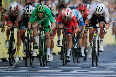 Sam Bennett of Ireland, wearing the best sprinter's green jersey, crosses the finish line ahead of second place Denmark's Mads Pedersen, for right, and third place Slovakia's Peter Sagan, second left, to win the twenty-first and last stage of the Tour de France cycling race over 122 kilometers (75.8 miles), from Mantes-la-Jolie to Paris, France, . Left is third place Slovakia's Peter Sagan