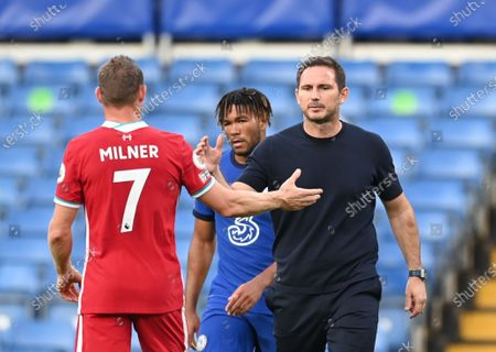 Chelsea's manager Frank Lampard greets James Milner of Liverpool (L) at the end of the the English Premier League match between Chelsea vs Liverpool in London, Britain, 20 September 2020.