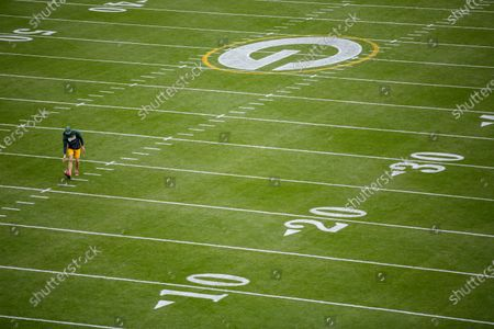 Green Bay Packers punter J.K. Scott warms up before an NFL football game against the Detroit Lions, in Green Bay, Wis