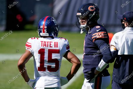 New York Giants wide receiver Golden Tate (15) talks with Chicago Bears quarterback Nick Foles (9) before an NFL football game in Chicago