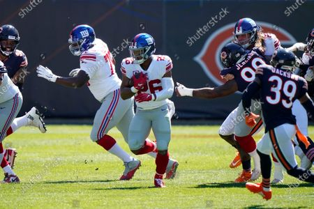New York Giants running back Saquon Barkley (26) runs the ball against the Chicago Bears during the first half of an NFL football game in Chicago
