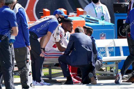 New York Giants running back Saquon Barkley (26) is attended to by medical staff after being injured against the Chicago Bears during the first half of an NFL football game in Chicago