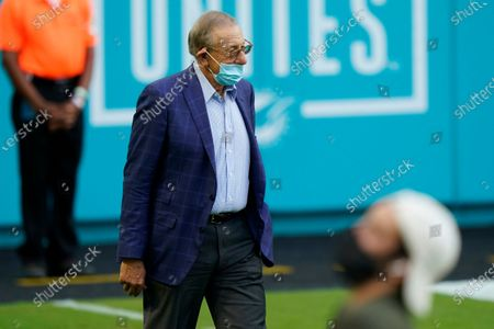 Miami Dolphins Stephen Ross walks the sidelines, during the second half of an NFL football game against the Buffalo Bills, in Miami Gardens, Fla. The Bills defeated the Dolphins 31-28