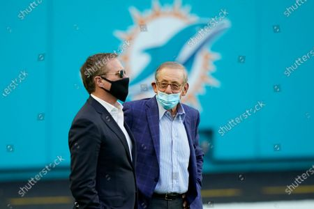 Miami Dolphins Stephen Ross talks to CEO Tom Garfinkel, during the second half of an NFL football game against the Buffalo Bills, in Miami Gardens, Fla. The Bills defeated the Dolphins 31-28