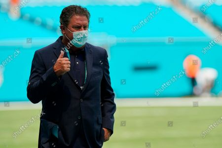 Former Miami Dolphins quarterback and special assistant to the team, Dan Marino walks the field before an NFL football game against the Buffalo Bills, in Miami Gardens, Fla