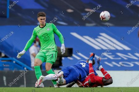 Chelsea's Andreas Christensen, center, tackles Liverpool's Sadio Mane during the English Premier League soccer match between Chelsea and Liverpool at Stamford Bridge Stadium