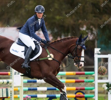 Stock Image of Zara Tindall in action with Class Affair during the show jumping at the Burnham Market International Horse Trials 2020