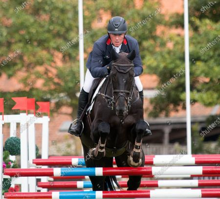 Stock Image of Oliver Townend with Tregilder during the Show Jumping at the Burnham Market International Horse Trials