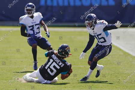 Jacksonville Jaguars quarterback Gardner Minshew (15) slides as Tennessee Titans defensive back Chris Jackson (35) closes in during the first half of an NFL football game, in Nashville, Tenn