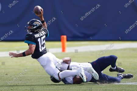 Jacksonville Jaguars quarterback Gardner Minshew (15) is sacked by Tennessee Titans defensive tackle Jack Crawford for a 20-yard loss in the first half of an NFL football game, in Nashville, Tenn