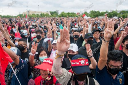 Protesters raise the three-finger salute during the demonstration at the Sanam Luang. Pro-democracy protesters converged at the historic royal heart of Bangkok to demand the resignation of the military-backed government and reforms of the monarchy, long considered a taboo subject in Thailand. The demonstrators gathered first at the Thammasat university campus on a college football field that was the scene of a massacre of left-wing students by pro-regime paramilitaries in 1976.