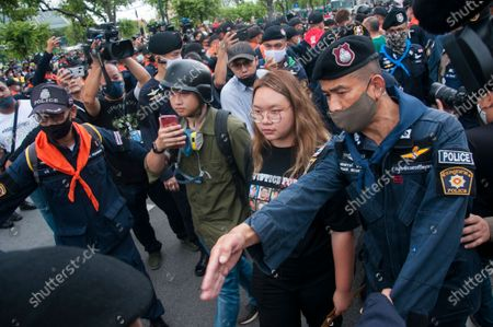 """Panusaya Sithijirawattanakul also know as """"Rung"""" came through the police line to negotiate with the police chief commander during the demonstration at the Sanam Luang. Pro-democracy protesters converged at the historic royal heart of Bangkok to demand the resignation of the military-backed government and reforms of the monarchy, long considered a taboo subject in Thailand. The demonstrators gathered first at the Thammasat university campus on a college football field that was the scene of a massacre of left-wing students by pro-regime paramilitaries in 1976."""