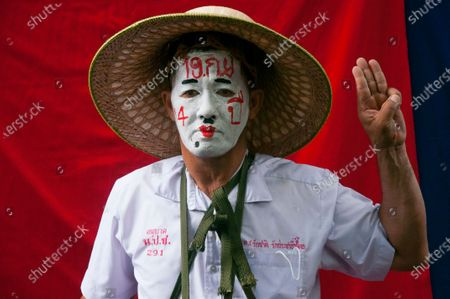 A protester wearing a school uniform and whose face is painted like a clown raises the three-finger salute during the demonstration at the Sanam Luang. Pro-democracy protesters converged at the historic royal heart of Bangkok to demand the resignation of the military-backed government and reforms of the monarchy, long considered a taboo subject in Thailand. The demonstrators gathered first at the Thammasat university campus on a college football field that was the scene of a massacre of left-wing students by pro-regime paramilitaries in 1976.