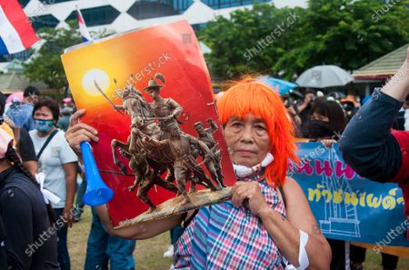 """A protester holds a placard of """"Taksin the great"""". The king of Thonburi kingdom who was a leader in the liberation of Siam from Burmese occupation after the Second Fall of Ayutthaya in 1767 during the demonstration at the Sanam Luang. Pro-democracy protesters converged at the historic royal heart of Bangkok to demand the resignation of the military-backed government and reforms of the monarchy, long considered a taboo subject in Thailand. The demonstrators gathered first at the Thammasat university campus on a college football field that was the scene of a massacre of left-wing students by pro-regime paramilitaries in 1976."""