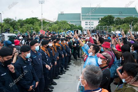 A confrontation is seen between the protesters and the police during the demonstration at the Sanam Luang. Pro-democracy protesters converged at the historic royal heart of Bangkok to demand the resignation of the military-backed government and reforms of the monarchy, long considered a taboo subject in Thailand. The demonstrators gathered first at the Thammasat university campus on a college football field that was the scene of a massacre of left-wing students by pro-regime paramilitaries in 1976.
