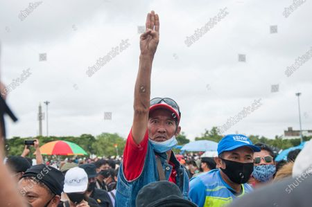 A protester raises the three-finger salute during the demonstration at the Sanam Luang. Pro-democracy protesters converged at the historic royal heart of Bangkok to demand the resignation of the military-backed government and reforms of the monarchy, long considered a taboo subject in Thailand. The demonstrators gathered first at the Thammasat university campus on a college football field that was the scene of a massacre of left-wing students by pro-regime paramilitaries in 1976.