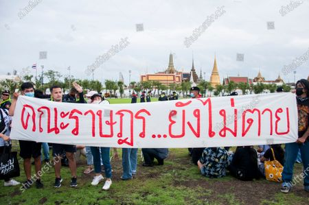 """Stock Picture of The placard from the pro-democracy protesters reading """"People's Party stay alive"""" seen during the demonstrations. Pro-democracy protesters converged at the historic royal heart of Bangkok to demand the resignation of the military-backed government and reforms of the monarchy, long considered a taboo subject in Thailand. The demonstrators gathered first at the Thammasat university campus on a college football field that was the scene of a massacre of left-wing students by pro-regime paramilitaries in 1976."""