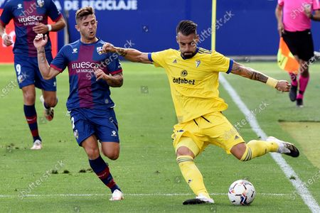 SD Huesca's midfielder Pablo Maffeo (L) duels for the ball with Cadiz CF's striker Alvaro Negredo (R) during their Spanish LaLiga Primera Division soccer match played at El Alcoraz stadium, in Huesca, northern Spain, 20 September 2020.