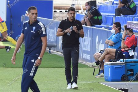 SD Huesca's head coach Miguel Angel Sanchez (C) reacts next to Cadiz CF's head coach Roberto Carlos Perera (L) during their Spanish LaLiga Primera Division soccer match played at El Alcoraz stadium, in Huesca, northern Spain, 20 September 2020.