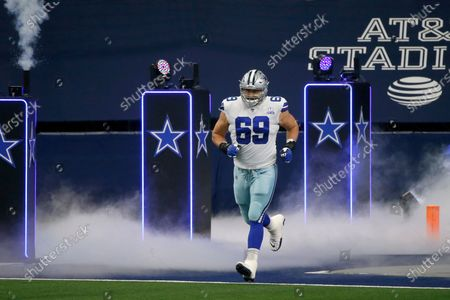 Dallas Cowboys offensive tackle Brandon Knight runs onto the field before an NFL football game against the Atlanta Falcons in Arlington, Texas