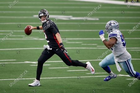 Atlanta Falcons quarterback Matt Ryan (2) rolls out under pressure by Dallas Cowboys defensive end Everson Griffen (97) in the second half of an NFL football game in Arlington, Texas