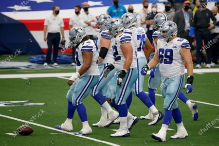 Dallas Cowboys center Joe Looney (73), offensive guard Connor Williams (52) and offensive tackle Brandon Knight (69) walk up the line of scrimmage during the second quarter of an NFL Football game in Arlington, Texas
