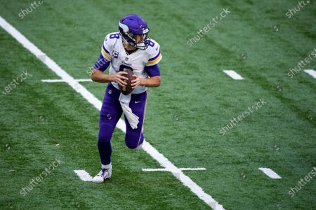 Stock Picture of Minnesota Vikings quarterback Kirk Cousins (8) rolls out of the pocket during an NFL football game between the Indianapolis Colts and Minnesota Vikings, in Indianapolis
