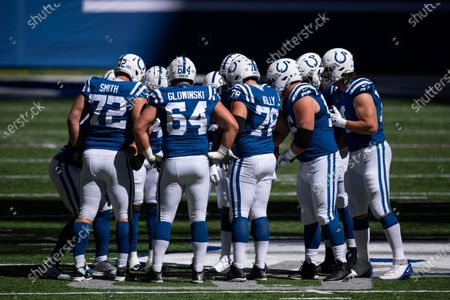 Indianapolis Colts offense huddles on the field during an NFL football game between the Indianapolis Colts and Minnesota Vikings, in Indianapolis