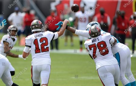 Carolina Panthers outside linebacker Adarius Taylor (57) hits Tampa Bay Buccaneers quarterback Tom Brady's (12) arm as he throws a pass during the first half of an NFL football game, in Tampa, Fla
