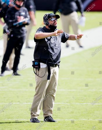 Stock Picture of Carolina Panthers head coach Matt Rhule calls a play to the offense in the second half against the Tampa Bay Buccaneers during an NFL football game, in Tampa, Fla