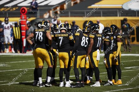 Stock Photo of Pittsburgh Steelers quarterback Ben Roethlisberger (7) huddles up the offense against Denver Broncos during an NFL football game, in Pittsburgh, PA