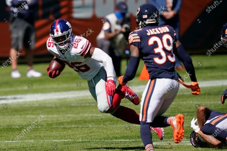 New York Giants running back Saquon Barkley (26) runs against the Chicago Bears during the first half of an NFL football game in Chicago