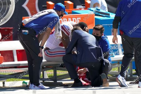 New York Giants running back Saquon Barkley is attended to on the bench by medical staff after being injured against the Chicago Bears during the first half of an NFL football game in Chicago