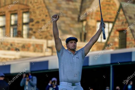Stock Photo of Bradley Dredge, of Wales,*** Brad Dalke, of the United States,*** Bryson DeChambeau, of the United States, reacts after sinking a putt for par on the 18th hole to win the US Open Golf Championship, in Mamaroneck, N.Y