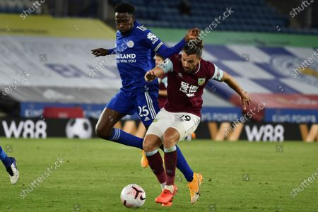 Leicester's Wilfred Ndidi, left, vie for the ball with Burnley's Jay Rodriguez during the English Premier League soccer match between Leicester City and Burnley at the King Power Stadium, Leicester, England