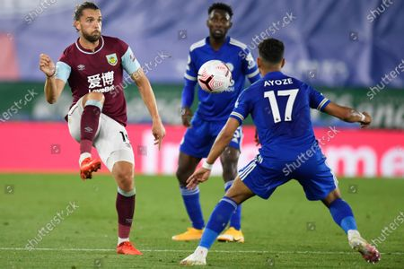 Burnley's Jay Rodriguez, left, is challenged by Leicester's Ayoze Perez during the English Premier League soccer match between Leicester City and Burnley at the King Power Stadium, Leicester, England
