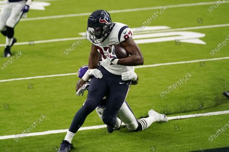 Houston Texans tight end Tyler Simmons (86) is hit by Baltimore Ravens defensive back Anthony Levine (41) as he makes a catch for a touchdown during the first half of an NFL football game Sunday, Sept.20, 2020, in Houston