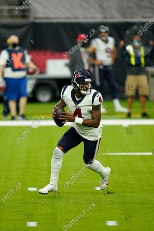 Houston Texans quarterback Deshaun Watson (4) rolls out as he looks to pass during an NFL football game against the Baltimore Ravens, in Houston