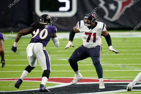 Stock Photo of Houston Texans offensive lineman Tytus Howard (71) looks to block during an NFL football game against the Baltimore Ravens, in Houston