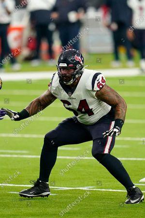 Houston Texans offensive lineman Senio Kelemete (64) looks to block during an NFL football game against the Baltimore Ravens, in Houston