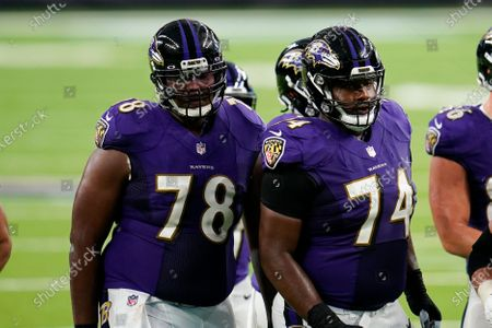 Baltimore Ravens lineman Tyre Phillips (74) and Orlando Brown Jr. (78) break the huddle during an NFL football game against the Houston Texans, in Houston