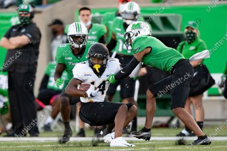 Appalachian State Mountaineers wide receiver Malik Williams (14) is tackled by Marshall Thundering Herd safety Derrek Pitts (1) during an NCAA football game on in Huntington, W.VA