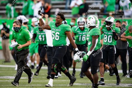 Marshall Thundering Herd offensive lineman Kendrick Sartor (56) celebrates their 17-7 win after an NCAA football game against the Appalachian State Mountaineers on in Huntington, W.VA