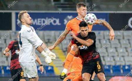 Galatasaray's Radamel Falcao (down-R) in action against Basaksehir's Martin Skrtel (up-R) and goalkeeper Fehmi Mert Gunok (L) during the Turkish Super League soccer match between Basaksehir and Galatasaray in Istanbul, Turkey, 20 September 2020.