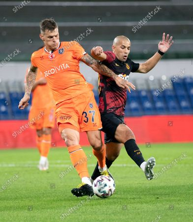 Galatasaray's Sofiane Feghouli (R) in action against Basaksehir's Martin Skrtel during the Turkish Super League soccer match between Basaksehir and Galatasaray in Istanbul, Turkey, 20 September 2020.