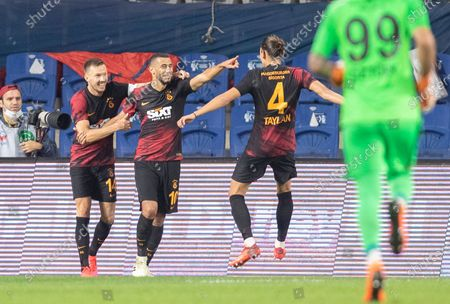 Galatasaray's Younes Belhanda (C) celebrates after scoring the 2-0 lead with team mates Martin Linnes (L) and Taylan Antalyali (R) during the Turkish Super League soccer match between Basaksehir and Galatasaray in Istanbul, Turkey, 20 September 2020.