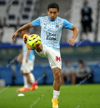 Marseille's Yuto Nagatomo warms up prior to the start of the French League One soccer match between Marseille and Lille at the Stade Velodrome in Marseille, France